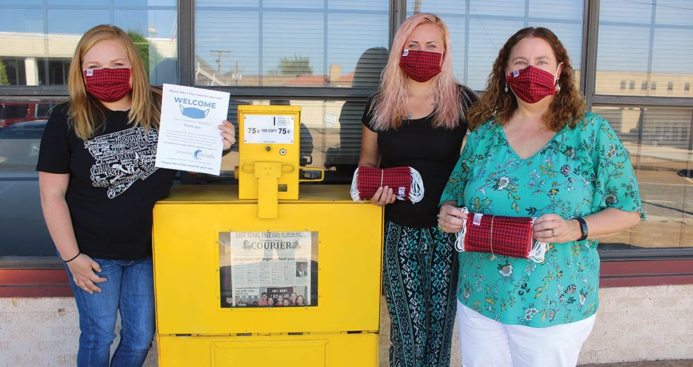 Employees of the Houston County Courier joined Managing Editor Toni Browning, a CERT member to deliver facial masks to Crockett businesses. Pictured from the left are Ashley Keenan, Brandy Jones and Toni Browning. ( ALTON PORTER|HCC PHOTO)